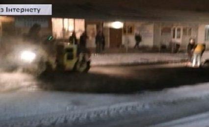 Сніг іде – асфальт кладуть: ремонт по-ужгородськи (ВІДЕО)